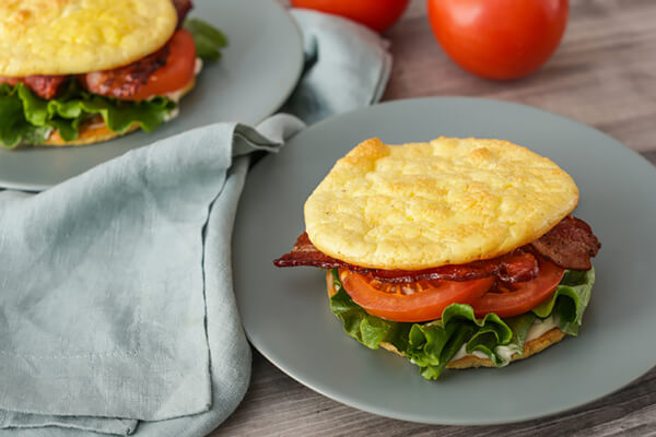 Making the cloud bread BLT sandwiches.