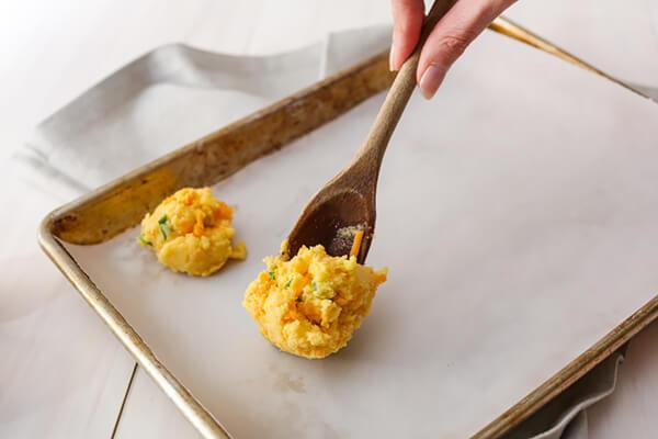 Placing the dough balls on the pan.