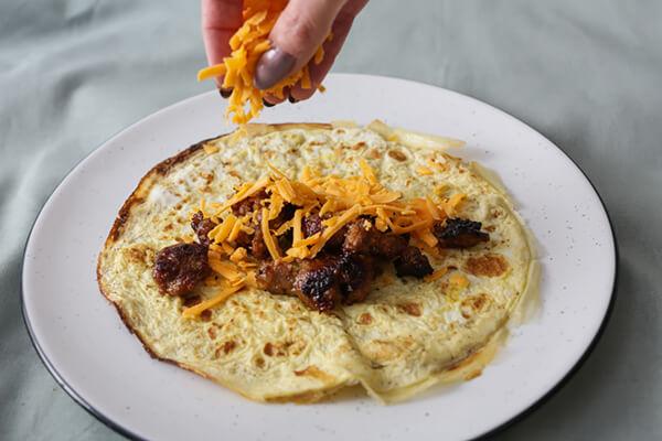 Adding filling to the enchiladas.