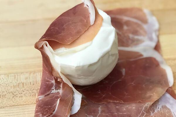 Wrapping the mozzarella.