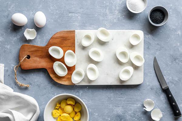 Halving eggs for deviled eggs.