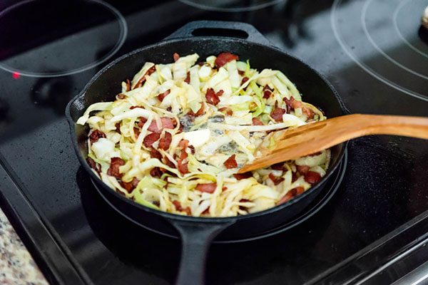 Frying cabbage with bacon.