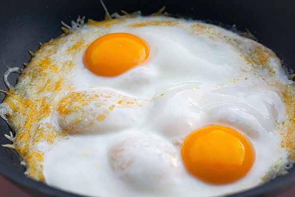 Cooked eggs in a skillet.