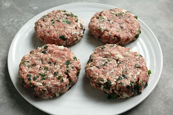 Forming the meat into burger patties.