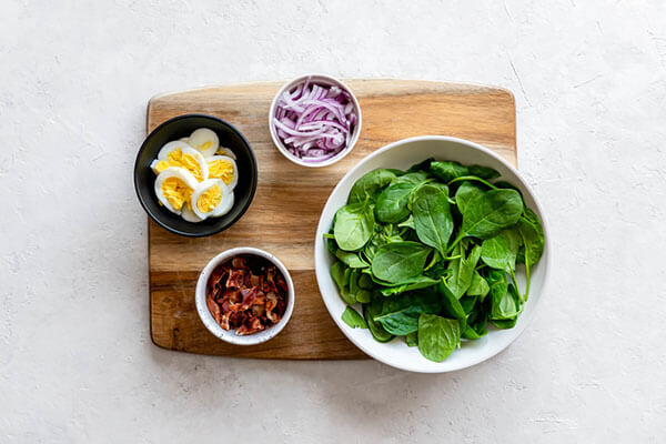 Spinach and salad ingredients.